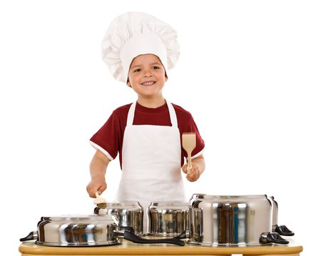 banging: Feel the beat of culinary art - boy with wooden spoons making some noise banging cooking pots, isolated Stock Photo