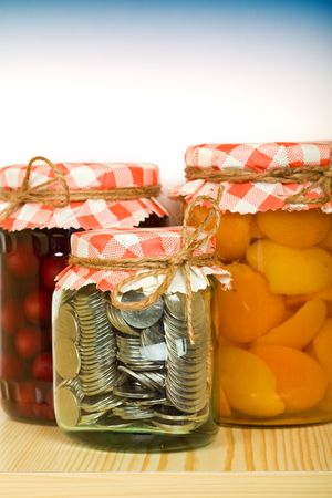 traditional goods: Put aside when you have plenty - money saving concept with coins in a jar