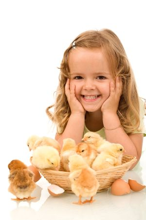 Happy little girl with a basket full of chickens - isolated