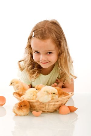 Smiling little girl with a basket full of young chickens - isolated Stock Photo - 5108026
