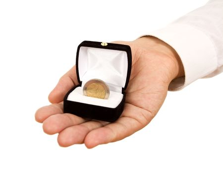 carreer: Man offering a coin in jewelry gift box - business concept