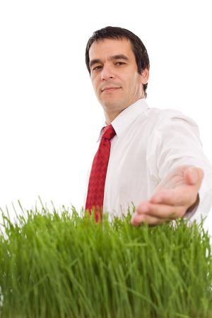 Confident businessman with grass - green environmental business concept, isolated Stock Photo - 5202871