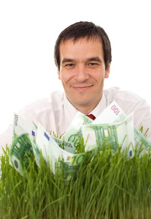 Businessman with green banknotes in the grass - isolated environment friendly business concept photo