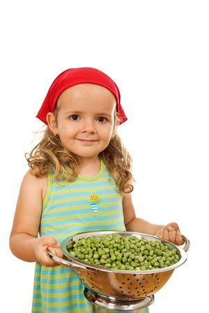 Little healthy smiling girl holding a bowl with lots of peas - isolated photo