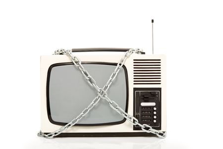 Vintage television set in chains - censorship concept, isolated Stock Photo - 6112687