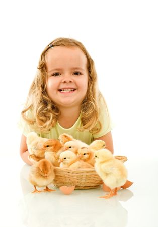Happy girl with her Easter baby chickens - isolated with reflection photo