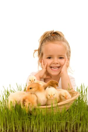 baby chick: Happy little girl with a basket full of small chickens - isolated
