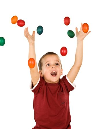 Little ecstatic boy with falling easter eggs - isolated photo