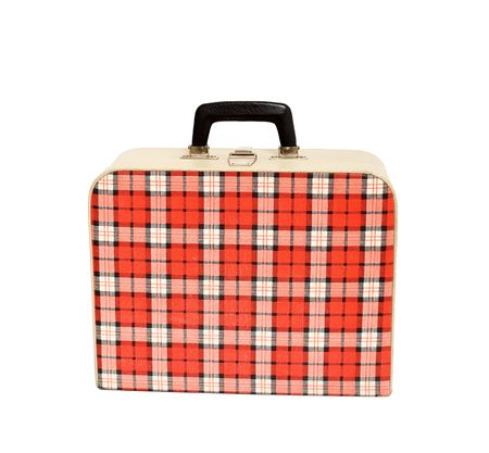 Old vintage suitcase with inverness pattern isolated on white
