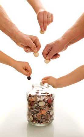 protect money: Hands of different generations putting coins in a  glass jar -financial education concept