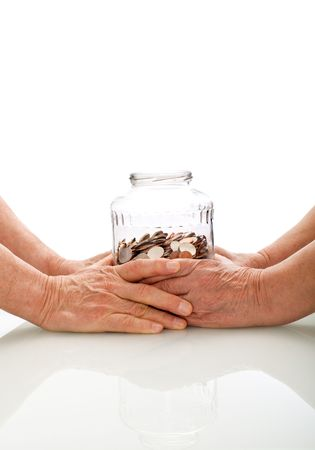 white fund: Senior hands holding a jar with coins - retirement fund concept, isolated