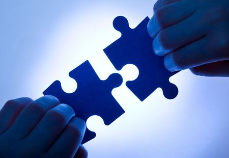 Business values - teamwork and collaboration concept with low key hands and puzzle pieces Stock Photo - 6703154
