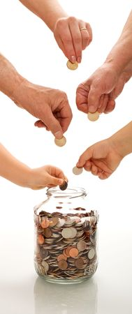 Saving concept with hands of different generations putting coins in a jar - vertical banner photo