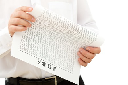 Man looking for job reading ads - isolated closeup Stock Photo - 7253275