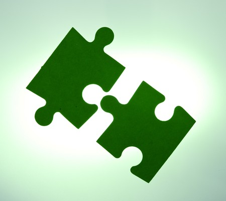 Backlit green puzzle pieces closeup - solution concept Stock Photo - 7466273