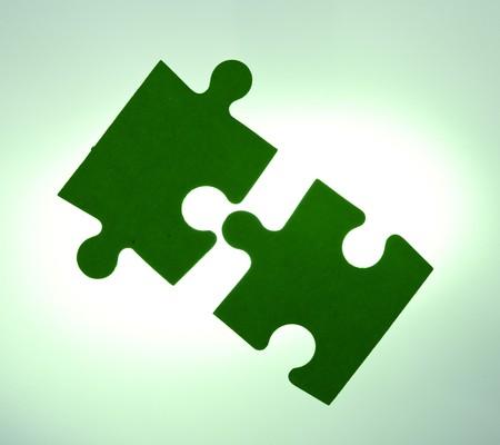 Backlit green puzzle pieces closeup - solution concept Stock Photo - 7466273