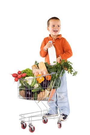 basic food: Little boy with basic healthy food in shopping cart laughing - isolated Stock Photo