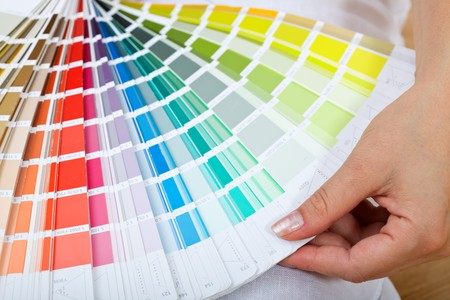 Picking the right paint - woman hand with color sample chart Stock Photo - 8054979