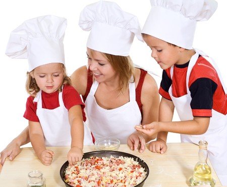 Woman making pizza with her kids at home - isolated Stock Photo