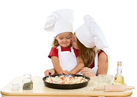 Woman and little girl making pizza together - isolated photo