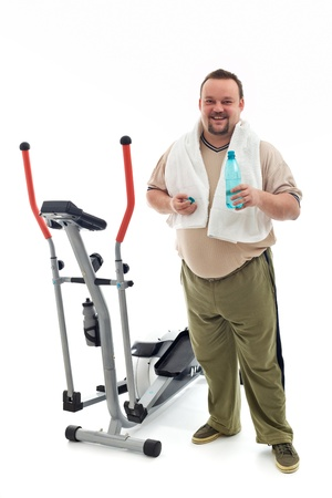 Man standing near an exercising device drinking water and resting - isolated Stock Photo - 8386044