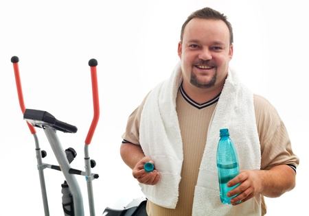 Happy man with water bottle after exercising on a trainer device - isolated, closeup Stock Photo - 8390594