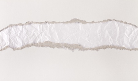 underlying: Torn paper strips series - cardboard revealing crumpled underlying layer