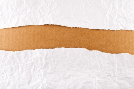 Torn paper-strip series - crumpled white paper revealing brown cardboard Stock Photo - 8390606