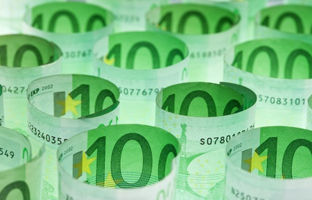 euro banknotes: Rolled hundred euro banknotes green money background
