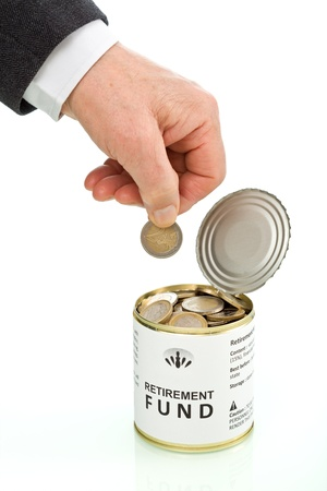 retirement savings: Senior man hand putting coin in retirement fund - savings concept, isolated Stock Photo