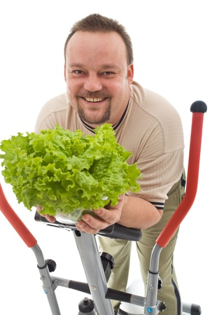 Overweight man with healthy lifestyle choices - exercising and eating fresh food, isolated Stock Photo - 9060523