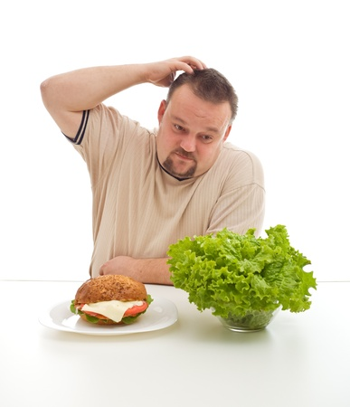 Hard diet choices concept with overweight man scratching his head - healthy or unhealthy Stock Photo - 9061490