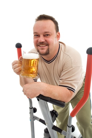 Happy man working out with a beer - isolated Stock Photo - 9054815