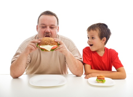 obese child: Man and boy with hamburgers - teaching healthy or unhealthy diet by example concept