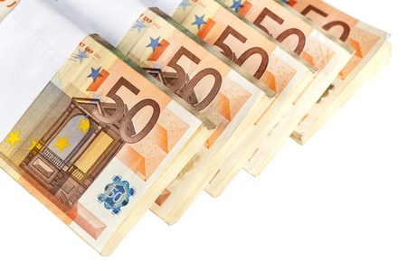 Stacks of fifty euro banknotes isolated on white Stock Photo - 9987214