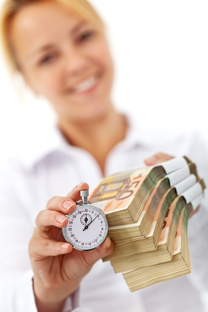 pile of money: Deadline for accessing european funds concept with banknotes and stopwatch Stock Photo