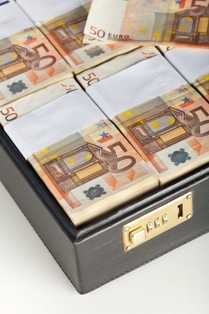 Fifty euro banknote stacks in black suitcase - detail photo
