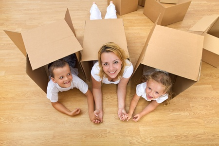 Family unpacking in a new home having fun on the floor photo