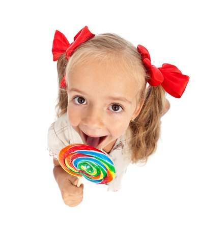Little girl with large lollipop candy - top view, isolated photo
