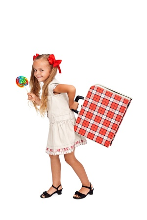 Pretty little girl with large lollipop and vintage suitcase - isolated photo