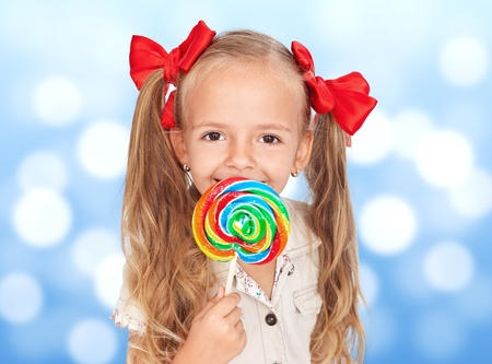 Happiness in the eyes of a child with lollipop