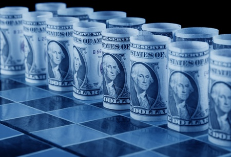 Money strategy concept with dollars as pieces on chess board - in cold blue shades photo