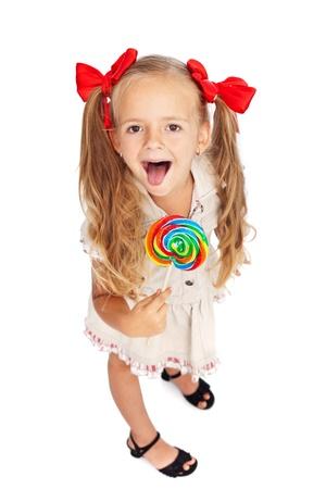 paletas de caramelo: Ni�a feliz con gran lollipop - aislados Foto de archivo