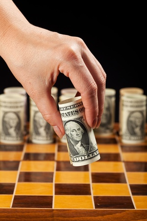 international investments: Money strategy concept with dollars and woman hand - closeup