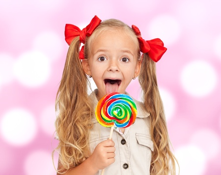 Life is great - extremely happy little girl with lollipop