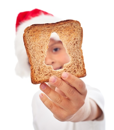 recieving: Sharing food at christmas time - kid holding a slice of bread Stock Photo