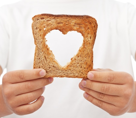 Sharing food with love - kid hands holding slice of bread photo
