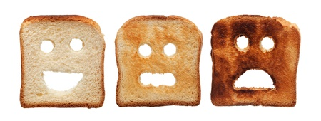 differently: Toast bread differently burned - summer skin care concept, isolated