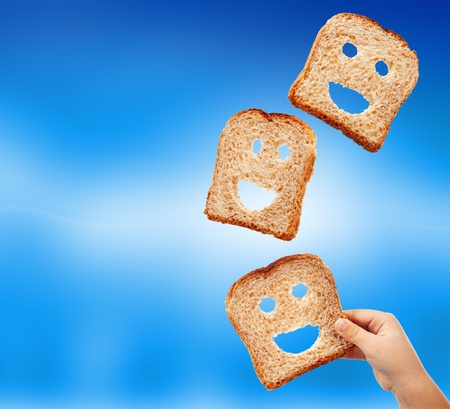 Basic food abundance - bread slices flying against blurry blue background Stock Photo - 11157177