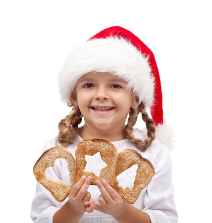 recieving: Little girl with slices of bread and santa hat - sharing and love at christmas time concept Stock Photo
